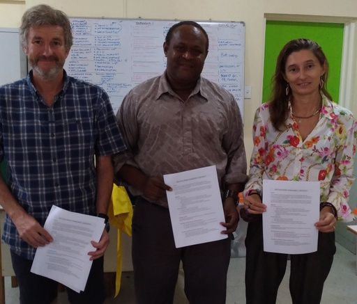 MASI representatives (left) and SECSIP's Chief Technical Adviser (right) sign and display the media training MOU